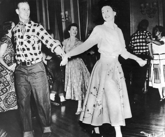 Dancing their way into wedded bliss. Philip spins his love on the dance floor. The stylish duo look straight out of a movie! **Watch Prince Philip talk about figuring out his role alongside The Queen in the next slide. Gallery continues after the video!**