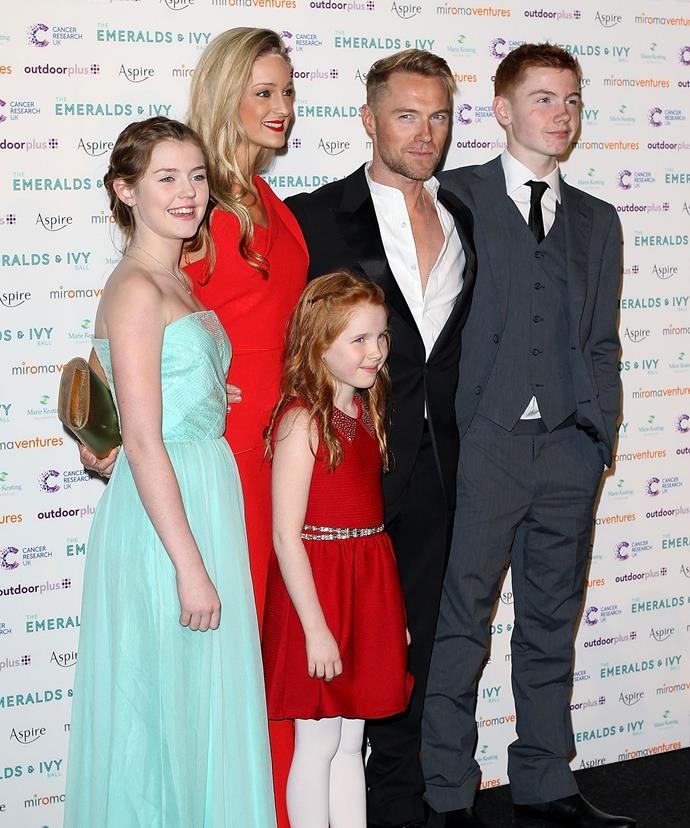 Ronan and Storm with his children Missy, Ali and Jack in 2013.