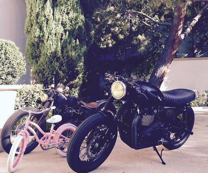 "Earlier in August David posted this hilarious snap of Harper's pink bike next to his motorbike and joked, ""Someone wants to go ride with her daddy."""