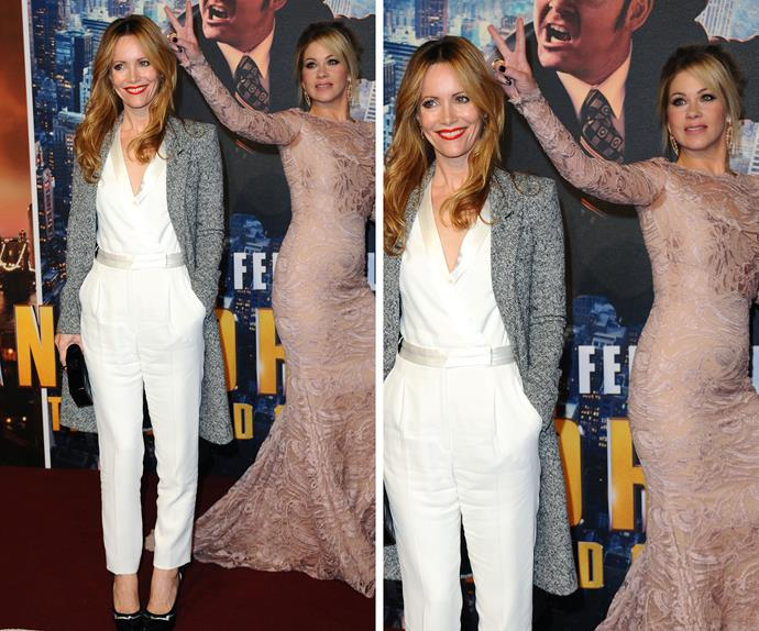 Bunny ears is a classic move for any seasoned photobomber and Christina Applegate owns it as her pal Leslie Mann stops for pictures on the *Anchorman 2* red carpet.