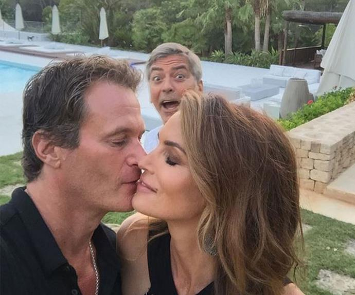 """Cindy Crawford and her husband Rande Gerber were just trying to enjoy and private show of affection for one another when George Clooney popped up… honestly, the nerve! The supermodel posted this hilarious pic over the weekend and quipped, """"photo bomber #HouseofFriends."""""""