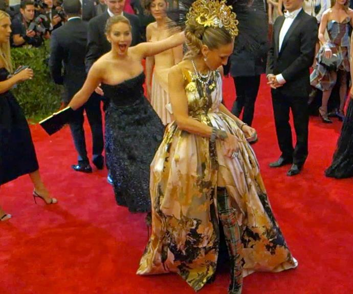 Sarah Jessica Parker's gown stole the show at the 2013 MET Gala – that was until repeat offender Jennifer Lawrence pulled an epic photobomb.