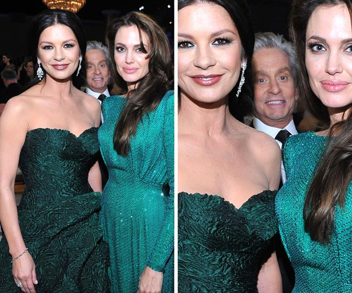 Clearly green with envy, Michael Douglas makes sure he is seen while Catherine Zeta Jones and Angelina Jolie get their photo taken during the 2011 Golden Globe Awards.