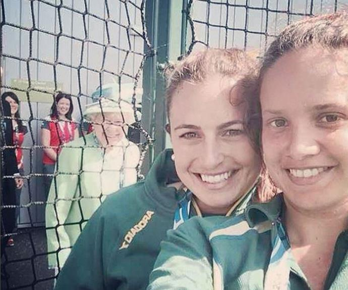 Everything else pales in comparison to this bad boy! Aussie Commonwealth Games athlete Jayde Taylor was snapping a quick selfie with her pal, when none other than The Queen of England photobombs the duo. How royally rad.