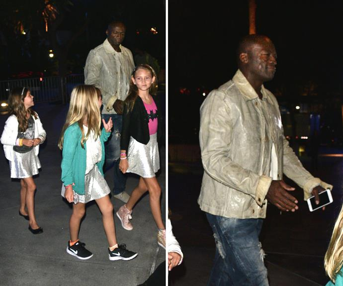 Seal was every part the doting dad as he took the girls to the Taylor Swift concert at LA's Staple Centre with his girlfriend Erica on Monday night.