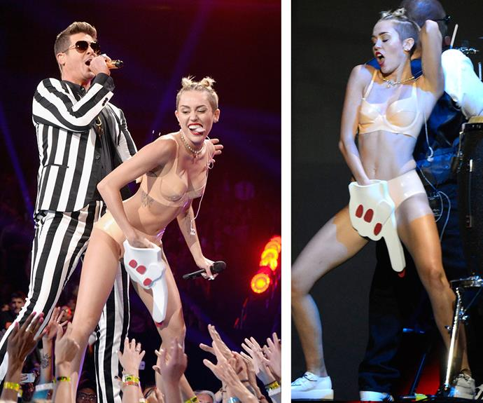 """He wanted me as naked as possible, because that's how his video was. It was very much a collaboration. My part *We Can't Stop* was all me. But when it went into *Blurred Lines,* that was his performance,"" this year's host Miley Cyrus recently told the *New York Times* of her headline-grabbing 2013 performance with Robin Thicke."