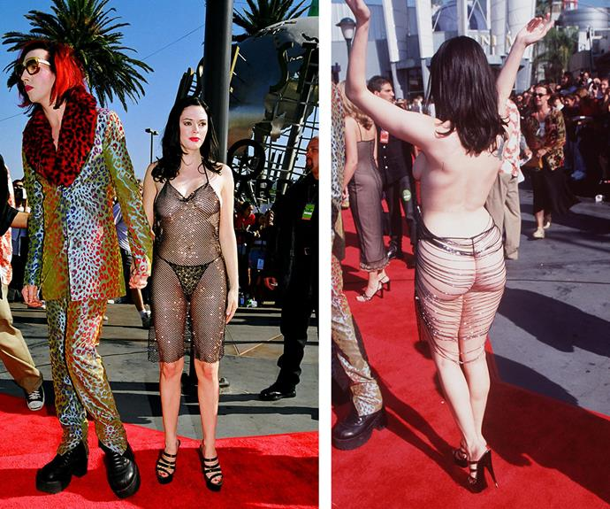 """I wore it to cause an uproar. But I'll confess that I did change into another dress after walking up the red carpet,"" actress Rose McGowan reflected of her booty-baring frock that she wore to the 1998 ceremony with her then-boyfriend, musician Marilyn Manson."