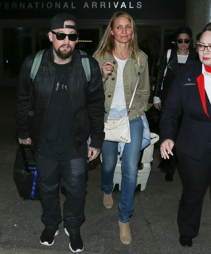 Cameron was sure to keep her belly hidden as she arrived into LA from Sydney.