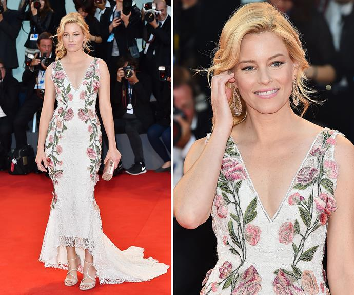 Elizabeth Banks stepped it up a notch in this form-fitting gown. Floral suits you Liz!