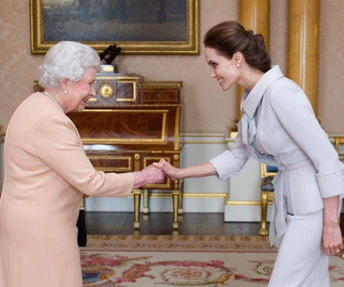She may be British royalty, but the Queen happily rubs shoulders with Hollywood royalty. Here she is [meeting Angelina Jolie in 2014.](http://www.womansday.com.au/celebrity/hollywood-stars/angelina-jolie-made-honorary-dame-by-the-queen-7174)
