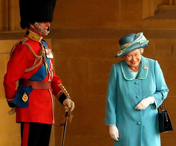 Philip always manages to put a smile on his wife's face. Queen Elizabeth II got a serious case of the giggles when she walked past her husband, who was standing to attention in his uniform and bearskin hat at Buckingham Palace back in 2005.