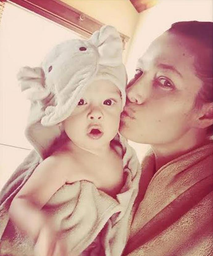 Ele-fun! Jessica Biel plants a tender smooch on her son after bath time.