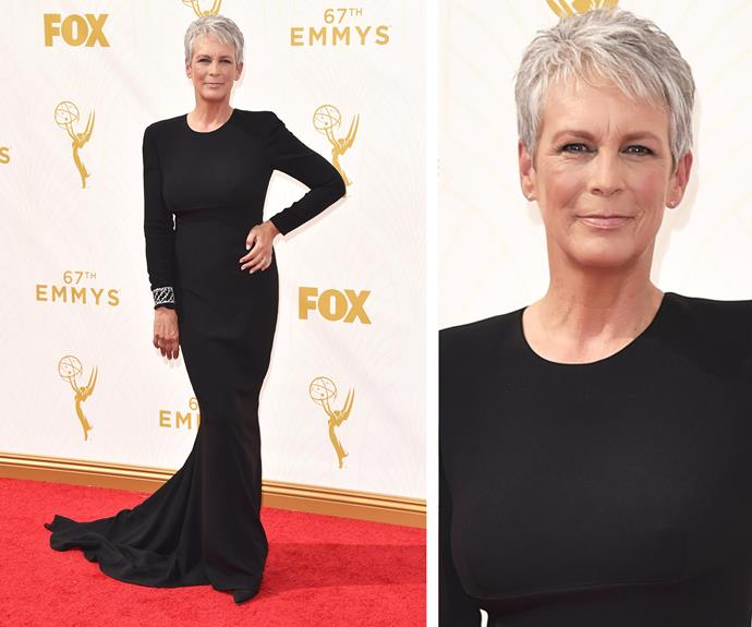 The original *Scream Queen* is back! Jamie Lee Curtis knows how to slay. Rocking her signature silver pixie cut, the Hollywood actress shows off her slender frame in a fitted, long-sleeve figure-hugging black dress. We adore the simple ensemble with a touch of glam with her embellished cuff on her right wrist.