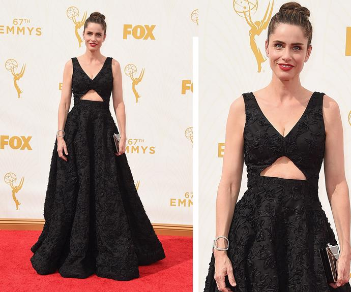 Amanda Peet opts for a classic black dress and a simple pulled-back bun.