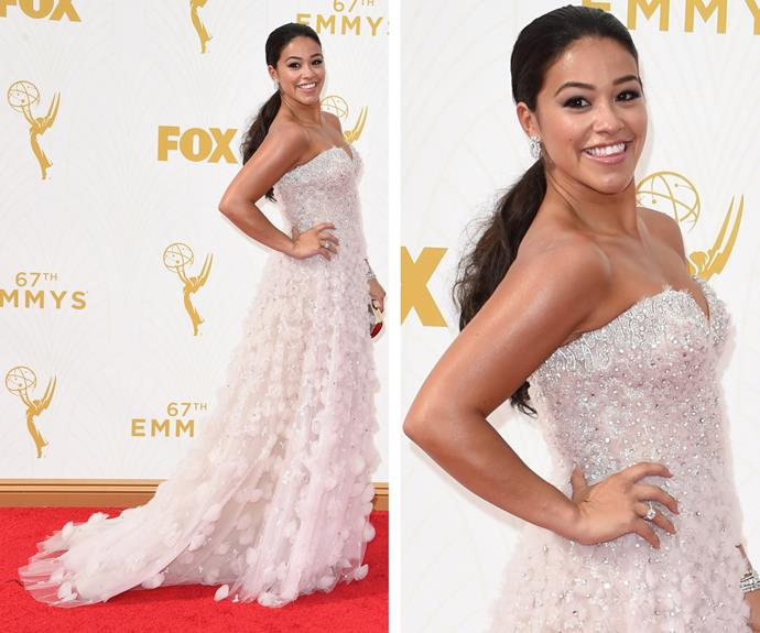 Gina Rodriguez is equal parts elegant and fun in this white strapless dress. The *Jane the Virgin* actress is all smiles, and we would be too! Check out the stunning beading.