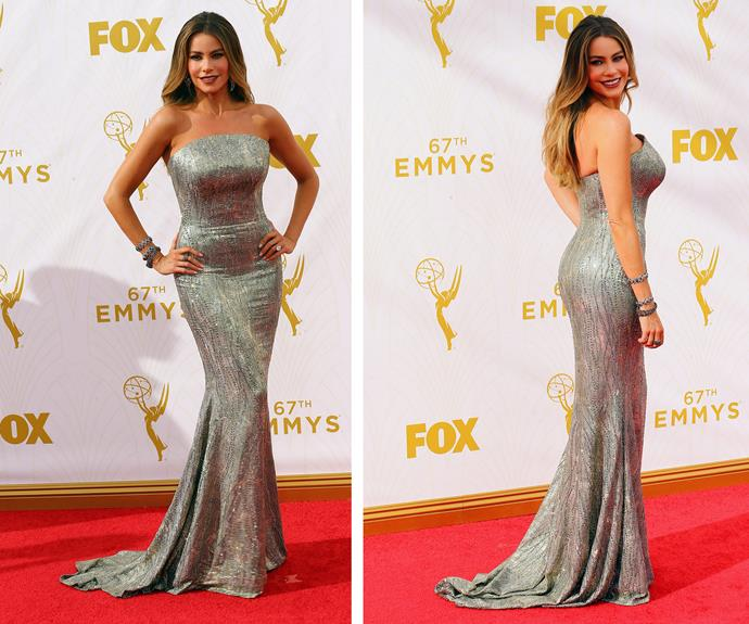 Ay, caramba! Sofia Vergara is a vision in this fitted gold-hue embellished gown. The *Modern Family* starlet shows off her assets in the strapless gown.