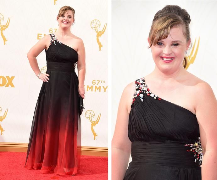 Jamie Brewer is burning up the red carpet in this cute one-shoulder dress. We love the embellished beading and balayage black to red hues in the *American Horror Story* actress' dress.