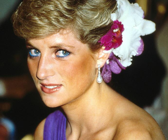 The original flower girl! Princess Diana oozes sophistication with with this floral up-do.