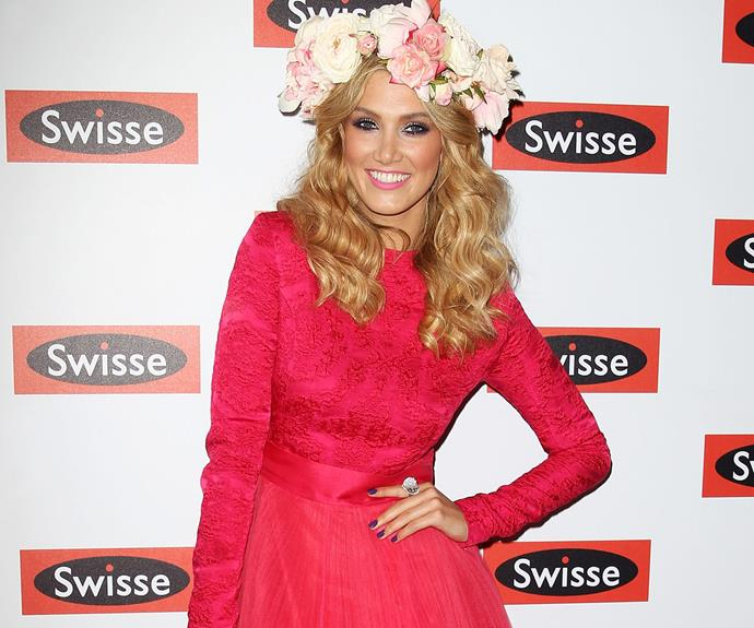 Off to the races with Delta Goodrem. Who needs a hat when you have flowers!?