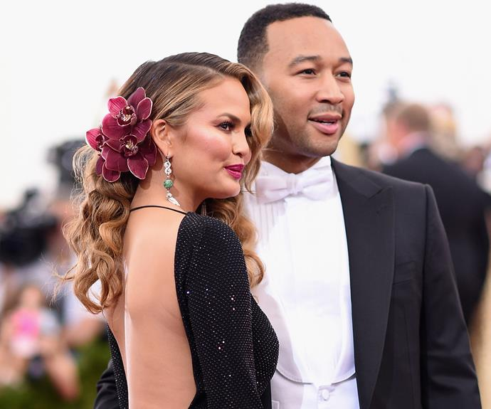 Chrissy Teigen's Thai roots a showing with this gorgeous maroon flower piece that matches her skin tone to perfection.