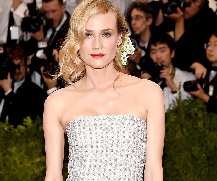 Diane Kruger is bloomin' on the forefront of great style. We love the way the tiny petals peek out from behind her 'do.