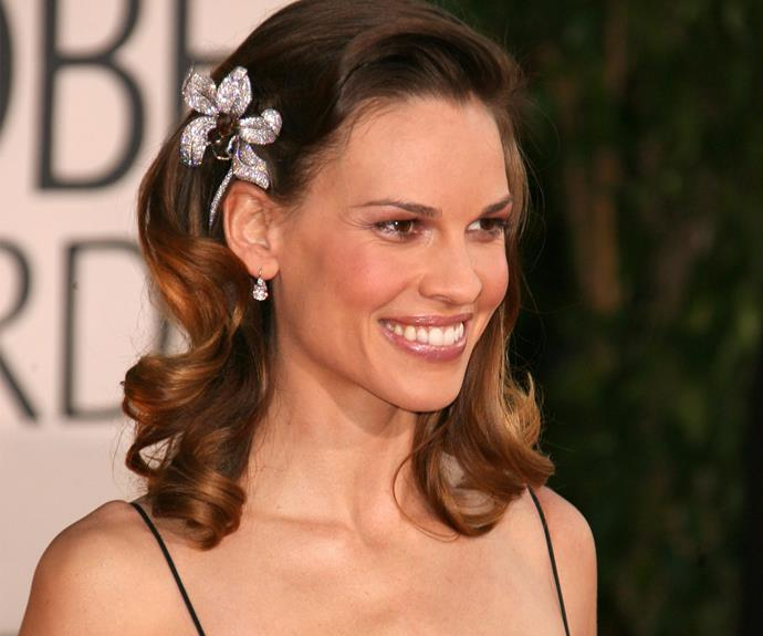 Very swanky indeed. Hilary Swank trades in real-life petals for shimmering crystals.