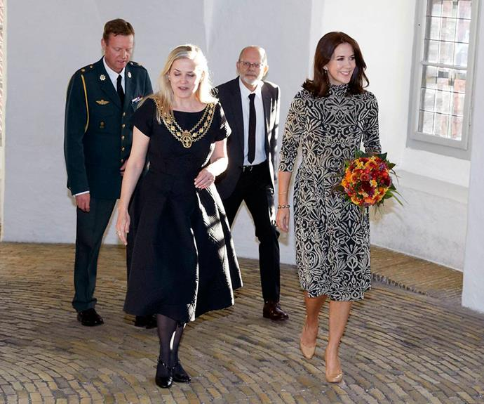 Princess Mary again proves why she was voted the most fashionable royal after stunning in this gorgeous printed dress and nude Louboutin heels.