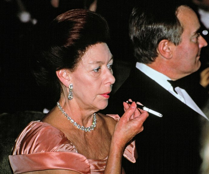 Decked out in her finest jewels Princess Margaret puffs back on a cigarette at the Gala For Aids Crisis Trust in 1991. Like her father, the royal was a heavy smoker and in 1985 she had part of her left lung removed.