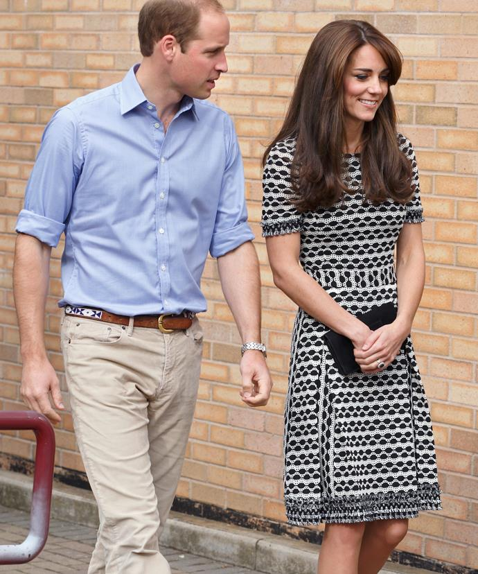 Good looking couple! Kate recycled one of her previous outfits from 2013, this black and white patterned Tory Burch dress, which she paired with black pumps and a black clutch.
