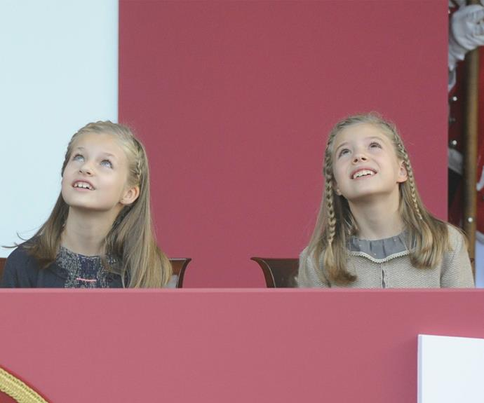 The Princesses were delighted by the air forces fly over, which left the sky with streaks of red and yellow, Spain's national colours.