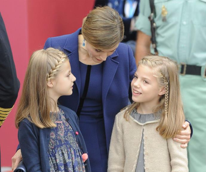 They were joined by their mother, Queen Letizia of Spain, who wore a sapphire ensemble.