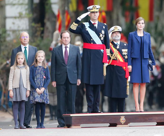 King Felipe VI and Queen Letizia salute the soldiers in the parade.