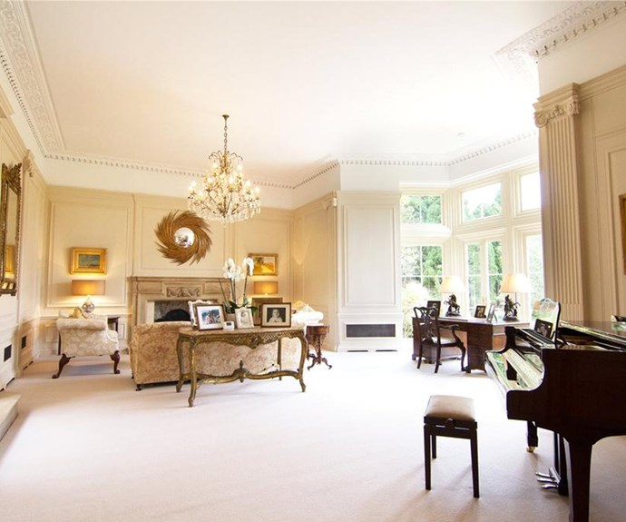 Check out the wood-panelled walls and stunning chandelier!