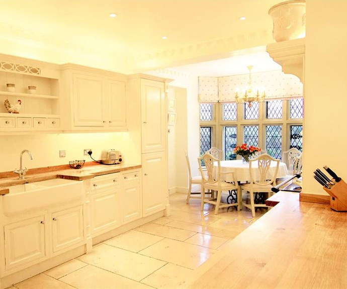 The all-white kitchen was custom-designed by designer, Clive Christian.