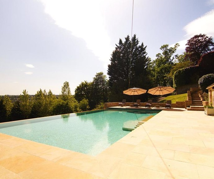 The infinity pool is tucked at the back of the property and looks over the valley below.