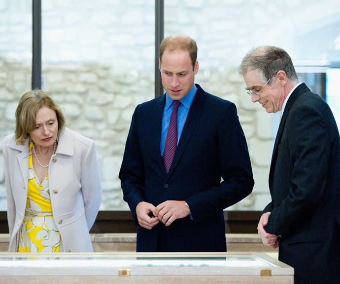 Prince William speaking with professors at the university.
