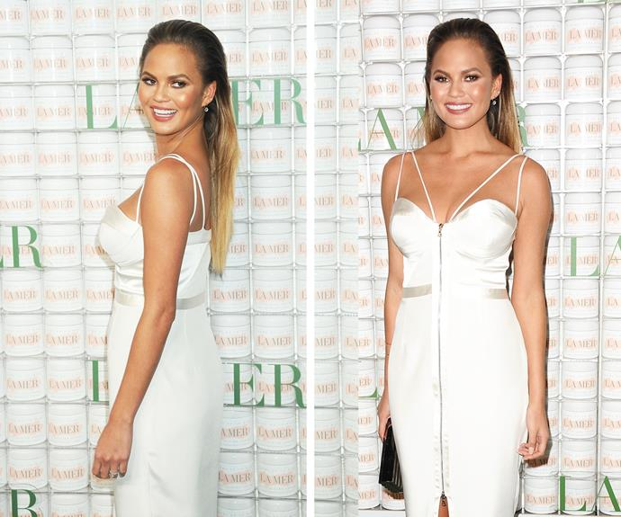 Heading out to her first event since announcing her pregnancy, Chrissy stunned in a white Kayat dress with a bustier neckline.