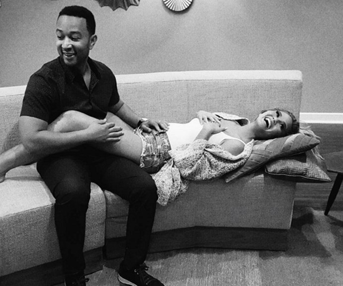 Chrissy announced her pregnancy on Instagram wearing a very casual look, consisting of a pair of denim shorts, a white tank top, a comfy grey cardigan and her best accessory, her hubby John.