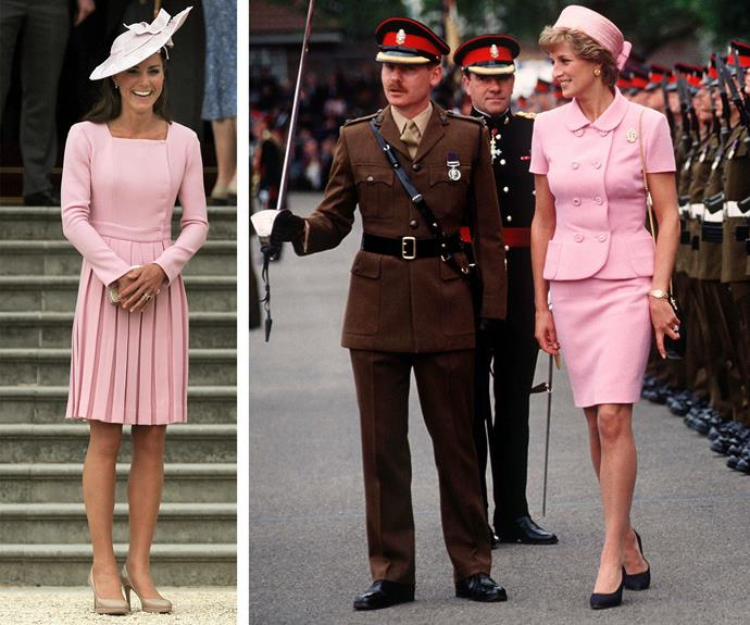 Both ladies are pretty in pink and what's a suit without a matching hat?