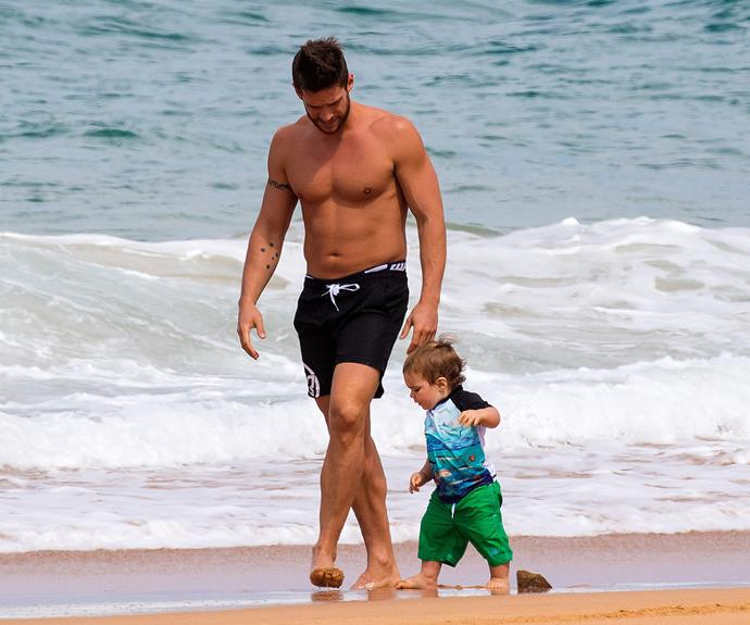 Dan Ewing had a splashing good time at the beach with his son, Archer.