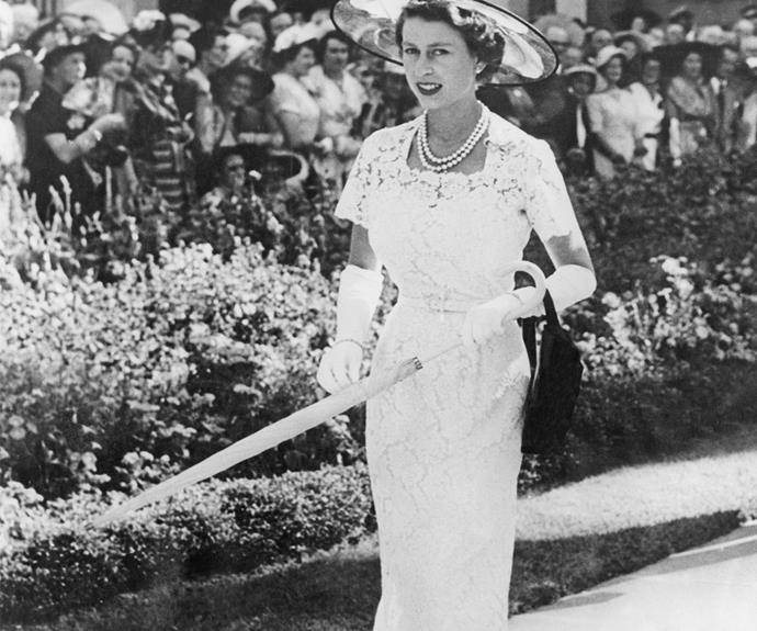 And of course the Queen of Style knows her way around lace! The newly crowned Queen Elizabeth wore this amazing dress with long gloves and a hat in Australia in 1954.