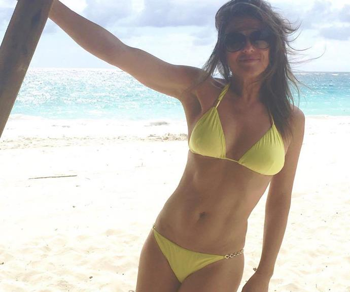 "You'd be forgiven if you thought Liz Hurley shared a flashback photo! The 50-year-old took to social media to post this ""mellow in yellow"" bikini snap from a recent getaway. It's safe to say the mother-of-one looks phenomenal."