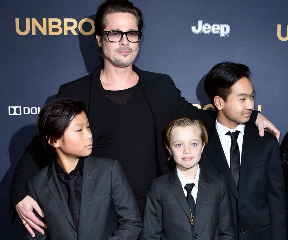 Brad Pitt with kids Pax, Shiloh and Maddox in 2014.