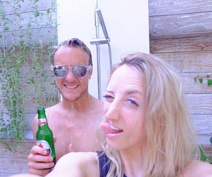 A beer, two babes and an outdoor shower - what more does a honeymoon need?