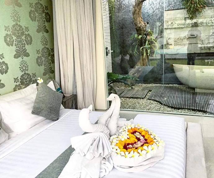 It's all in the detail! A stunning floral display and towel swans adorn the bed.