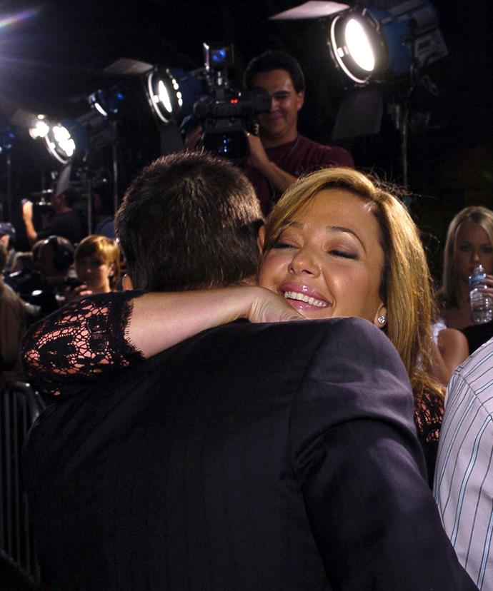 Leah Remini and Tom Cruise embracing in 2004.