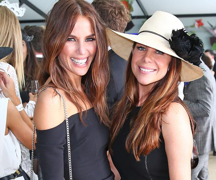 Summer Bay hotties! Jodi Anasta strikes a pose with fromer *Home and Away* co-star, Kate Ritchie.