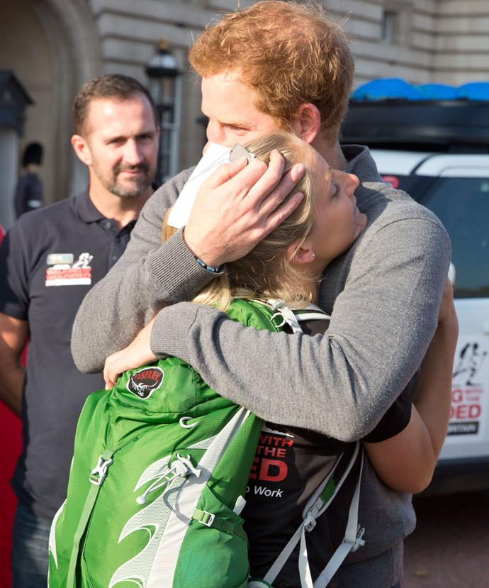 In 2015, King of the hugs Prince Harry shared a tender moment with US Marine, Kirstie Ennis at Buckingham Palace.