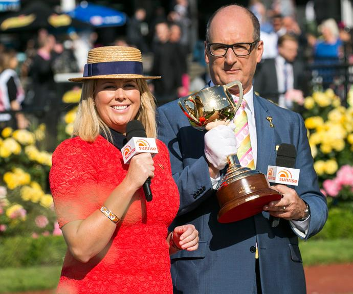 Lady in red! Samantha Armytage worked a fitted lace dress as she commentates the day's proceedings with colleague and fellow *Sunrise* host, Kochie.