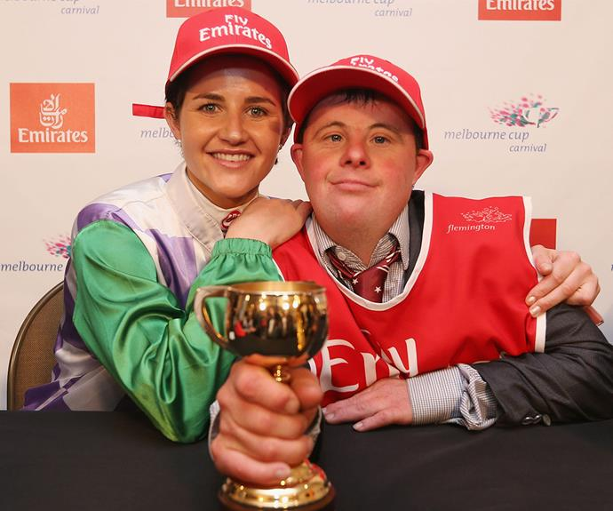 Siblings united! The talented brother-sister duo beam with pride as they hold the prestigious Melbourne Cup.